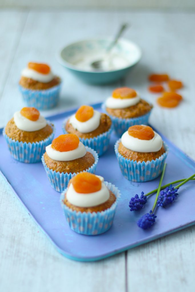 Healthy carrot cake muffins with yoghurt & apricot egg top